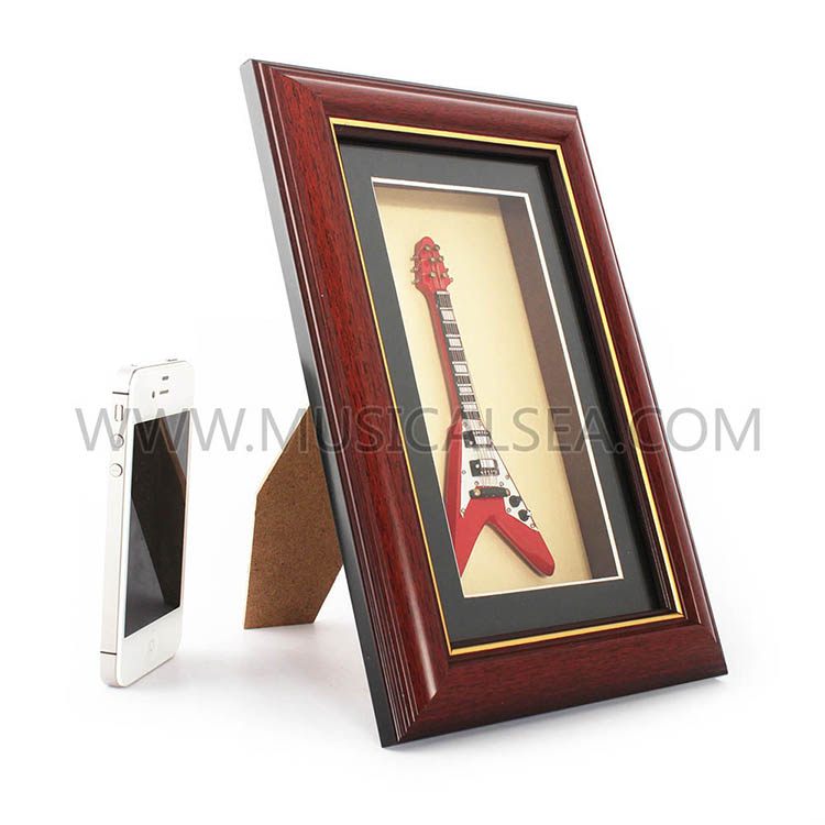 Photo frame with mini guitar and decorative p