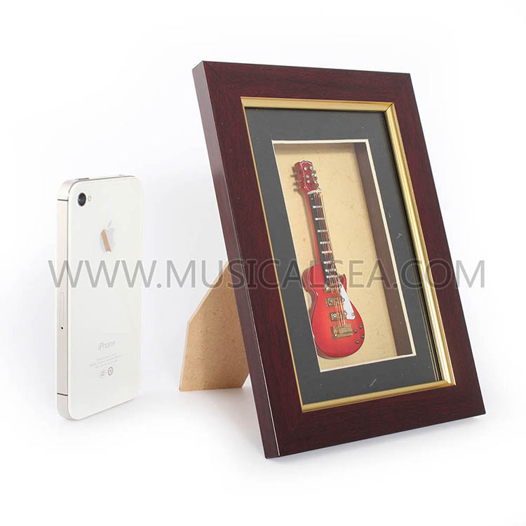 Decorative picture frame with mini electric g