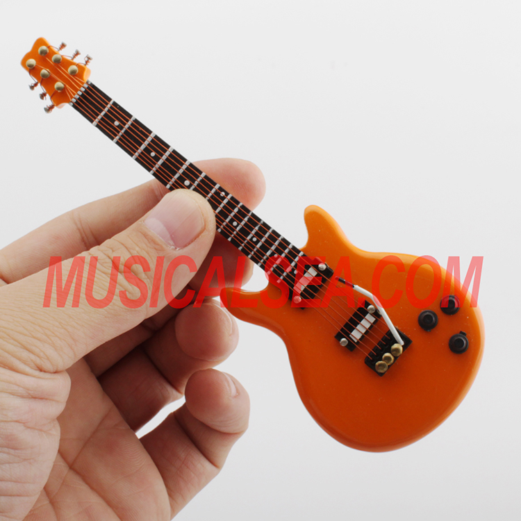 Miniature wood guitar ornament that different