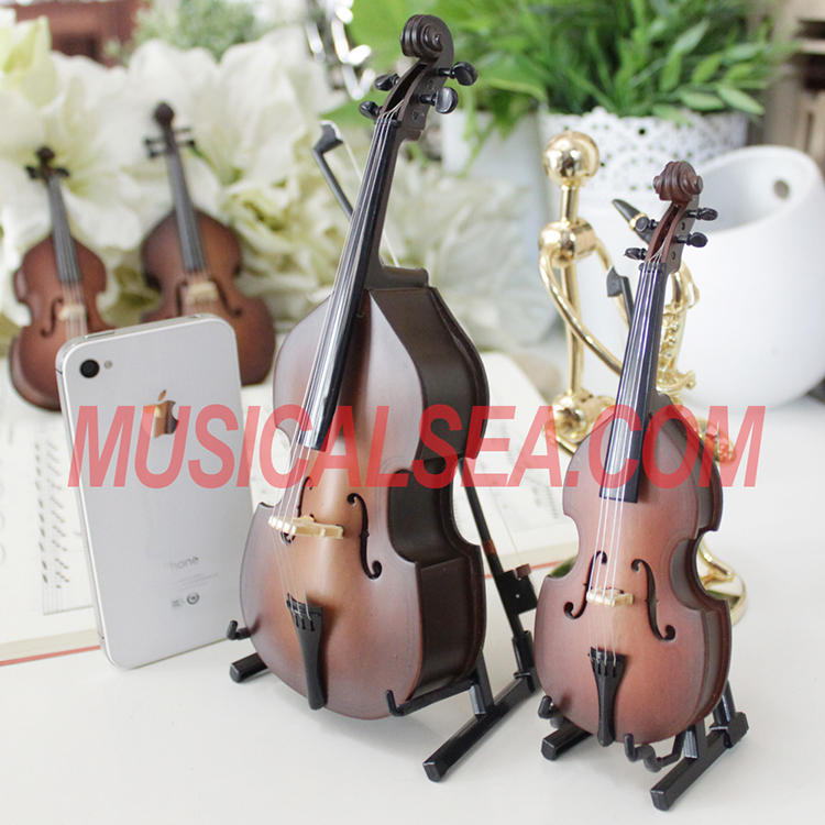 Miniature brown violin figurines with music b